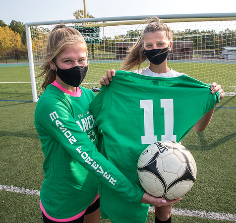 201006 LewPort Soccer 2<br /> James Neiss/staff photographer <br /> Lewiston, NY - Lewiston Porter girls soccer captains Sara Woods and Gracie Auer show off shirts honoring Mason Monteleone.