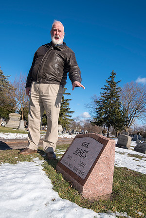 """201229 Kirk Jones Enterprise 1<br /> James Neiss/staff photographer <br /> Niagara Falls - Tim Baxter, director of operations at the Oakwood Cemetery Association, stands next to the gravesite donated to Kirk Jones by Oakwood. """"We had heard that Kirk Jones had not been claimed at the morgue, so the Board decided to donate a grave, as we had done in the past,"""" said Baxter. (Annie Edson Taylor and Carlisle Graham's graves were both donated by the cemetery.) <br /> <br /> In 2003, Kirk Jones became the first person without protection to survive going over Niagara Falls. In June of 2017, the daredevils body was discovered a couple months after being suspected of going over Niagara Falls in an inflatable ball."""