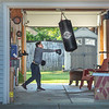 "200923 Enterprise 1<br /> James Neiss/staff photographer <br /> Lewiston, NY - Knocking it out before class - Liam Sheehan, 9, shows a punching bag who's boss in his Oxbow Lane garage before school. Liam is now a 100%  ""Remote Lancer"" with LewPort and he boxes at home from time to time for exercise and stress relief before class. Liam learned to box at Casal's Boxing Club, but since Covid came along he boxes and attends class at home. His mother Stacey, said ""Liam hopes to go back to casal's and to school one day, but it's safer for us at home at present."""