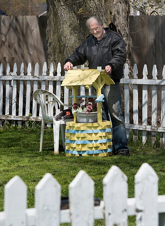 """200506 Enterprise 3<br /> James Neiss/staff photographer <br /> Lockport, NY - Art Huntington was spotted fixing his wishing well in the backyard of his Prospect Street home. When asked if any of his wishes came true, Huntington said, """"I suppose a few of them actually did!"""""""