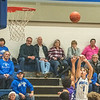 James Neiss/staff photographer <br /> Newfane, NY - Newfane #1Sam Capen shoots from the side during basketball game action against Albion.