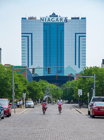 200622 Tourism Enterprise 2<br /> James Neiss/staff photographer <br /> Niagara Falls, NY - Talisha Maddrey and Kenny Hawkes of Newcastle, Delaware, ride rented bicycles up Old Falls Street on their way to see Niagara Falls during a visit to the area.