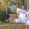 201123 Enterprise 2<br /> James Neiss/staff photographer <br /> Cambria, NY - Trying To Impress Management - Cory Bannach, of Bill & Gerry's Kydd's farm Market on Saunders Settlement Road, had to work with a Frosty supervisor as he wrestles a Christmas Tree into place for sale at the Market.