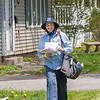 200507 Postal Worker 1<br /> James Neiss/staff photographer <br /> Lockport, NY - Brian McEachon delivers mail along E. Union Street in Lockport. McEachon, with 10 years on the job, said he's read up on how the Coronovirus spreads on different surfaces and makes sure to sanitize his hands between stops to his truck.