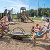 200903 Playground 1<br /> James Neiss/staff photographer <br /> Gasport, NY - Children enjoy playing at the new playground behind the Gasport Elementary School during a soft opening on Thursday. Playing from left, Cole Stopa, 5, Maci Stopa, 8, teacher Kelli Hare, Lainey Powell, 4, her mother Jen, Emma LaMacchia, 6 and her mom Kimberly. All the adult women are 3rd grade teachers at the school.