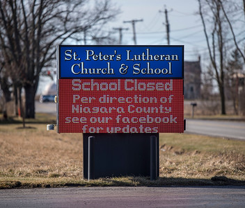 200316  Virus - Schools 5 James Neiss/staff photographer  Sanborn, NY - A sign at St. Peter's Lutheran Church & School notifies parishioners that the school is closed along with all the other schools in Niagara County.