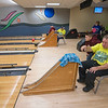 James Neiss/staff photographer <br /> Niagara Falls, NY - Volunteer Trent Siuta, 10, keeps an eye on the lane as Henry Smith sends the ball down the lane, as he and other members of the WNY Challenger Sports League, Ron Dormer and Frederick Reynolds, at left, enjoy an afternoon at the Rapids Bowling Center. The Challenger Sports League, Inc. brochure say the league  is a safe happy place for individuals of all ages and with disabilities to experience the joy of athletic participation.