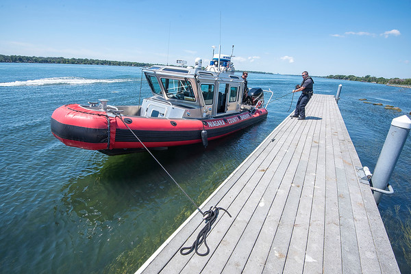 200813 Marine Patrol 3<br /> James Neiss/staff photographer <br /> North Tonawanda, NY - Niagara County Sheriff LT. Patrick Rindfleisch and Deputy Paul Harrier patrol the upper Niagara River off Gratwick Riverside Park.