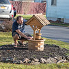 201120 Enterprise 2<br /> James Neiss/staff photographer <br /> Niagara Falls, NY - Nick Akins probably wishes the wind would stop blowing over his wishing well in front of his 99th Street home. Aikins and many other Niagara County residents had to put up with high winds these last few days.