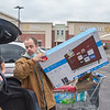 201127 Black Friday 2<br /> James Neiss/staff photographer <br /> Lockport, NY - Shane Storms loads his car after snagging a Black Friday TV deal at Walmart in Lockport.