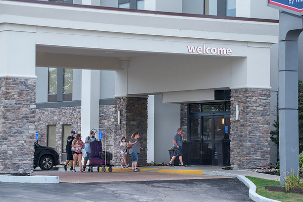 200901 Hotels <br /> James Neiss/staff photographer <br /> Niagara Falls, NY - Guests head into the Hampton Inn by Hilton on Rainbow Boulevard.