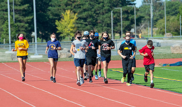 200921 NF School Sports 2<br /> James Neiss/staff photographer <br /> Niagara Falls, NY - Niagara Falls cross country members practice on Monday, the first day for school sports during the COVID-19 epidemic.