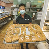 200805 Como Open 2<br /> James Neiss/staff photographer <br /> Niagara Falls, NY - Barbara Antonacci shows off the classic Como pizza bread, a favorite of many. The Como is now open for business.