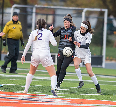201103 Soccer 2<br /> James Neiss/staff photographer <br /> Wilson, NY - Roy-Hart #8 Reanna Perkins and WIlson #21 Kaylee Allcorn vie for the ball during soccer game action in Wilson.