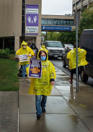 """200930 NFMMC Picket 1<br /> James Neiss/staff photographer <br /> Niagara Falls, NY - Niagara Falls Memorial Medical Center Workers picket outside the hospital on Wednesday. <br /> <br /> <br /> Begin forwarded message:<br /> <br /> From: April Ezzell <br /> Subject: Niagara Falls Memorial Medical Center Workers to picket over short staffing levels Weds from 11am-1pm<br /> Date: September 28, 2020 at 9:37:14 AM EDT<br /> <br />  <br /> FOR IMMEDIATE RELEASE<br /> Date: Friday, September 28, 2020<br /> Contact: Allison Krause, 1199SEIU, 315-679-6032<br />  <br /> Niagara Falls Memorial Medical Center Workers to Hold Informational Picket on 9/30 <br /> --- <br /> Essential healthcare workers say staffing levels at the hospital are critically low and demand that management provide appropriate levels of staff to ensure quality care to patients.<br /> <br /> What:            Informational Picket <br /> Who:              Niagara Falls Memorial Medical Center Workers<br /> Date:              Wednesday, September 30 from 11am-1pm <br /> Location:       Niagara Falls Memorial Medical Center<br /> 621 10th St., Niagara Falls, NY 14301<br /> <br /> More than 700 essential healthcare workers represented by 1199SEIU, United Healthcare Workers East, at Niagara Falls Memorial Medical Center plan to hold an informational picket on Wednesday, September 30, to demand proper staffing levels in the hospital. In the last several months, caregivers have submitted 150 short staffing forms citing dangerously inadequate staffing levels throughout the hospital which could impact the quality of care provided to patients.<br />  <br /> """"We have been stripped down to the bone. Some nights I'm doing beds and taking vitals because we don't have anyone from housekeeping on,"""" says 1199SEIU Delegate Evelyn Harris, who has worked at the institution for 43 years. """"Not being able to give hands on care and do all I can for my patients fractures me to my soul.""""<br /> <br /> Union organizers have filed ch"""