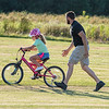 200805 Enterprise 2<br /> James Neiss/staff photographer <br /> Lockport, NY - Houston, we have liftoff! - Young Leah Bald, 6, balances on her bicycle masterfully the moment her father Rain Bald let go. Leah's parents Bald and Jaclyn took turns practicing with Leah at the Niagara County Model Plane Field on Day Road.