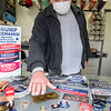 201002 Trump Trailer 4<br /> James Neiss/staff photographer <br /> Niagara Falls, NY - Trump trailer owner Tom, shows off some of the smaller items available. Tom said the Trump bobblehead was very popular.