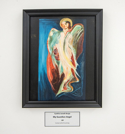 James Neiss/staff photographer <br /> Niagara Falls, NY - My Guardian Angel, Oil, by Cynthia Jozwik Burge, is on display in the Townsend Gallery at the NACC. The Niagara Arts & Cultural Center is hosting an exhibition Angels, Messengers & Celestial Guardians, Feb 3– March 4, with an Artist Reception on Feb 8, from 5-7 p.m.