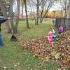 201105 Enterprise 2<br /> James Neiss/staff photographer <br /> Niagara Falls, NY - Papa Daniel Whiting of Stevenson Avenue thought he was making progress getting the leaves to the curb for pickup, but his grandchildren Austin Clinton, 8, and his twin sisters Danica and Bria, both 6, had a better idea for their use.