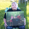 200831 Overdose Awareness 2<br /> James Neiss/staff photographer <br /> Niagara Falls, NY - Carole Woods of Lockport holds a photo of her son Daniel Swatsworth who died of an overdose in 2016. Woods and a crowd of others attended the 4th annual Lockport International Overdose Awareness Day Rally at Veterans Park.