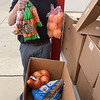 200529 Food Giveaway 3<br /> James Neiss/staff photographer <br /> Niagara Falls, NY - Volunteers distributed boxes of food, part of a program sponsored by the Cornell Cooperative Extension of Niagara and the USDA. Participants each received a 20 lb. box of food and volunteers said they came prepared to give away 200 boxes at the Niagara Street School.