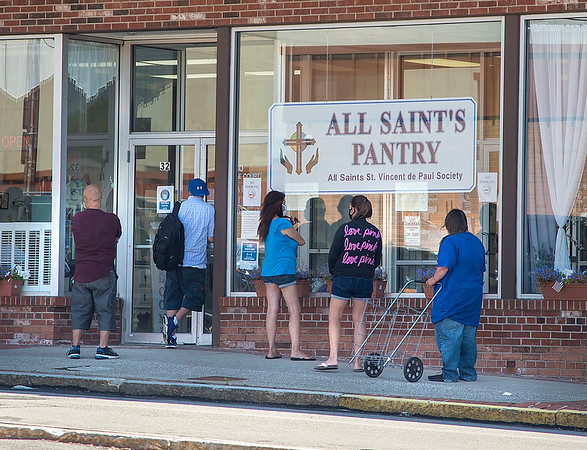 200818 Enterprise 3<br /> James Neiss/staff photographer <br /> Lockport, NY - Patrons of the All Saint's Pantry line up outside to pick up food. The high unemployment numbers due to the COVID pandemic are forcing many to use these services.