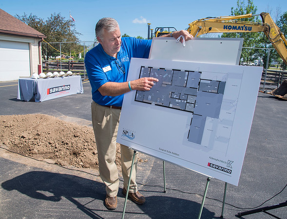 James Neiss/staff photographer <br /> Wheatfield, NY - Tim Brennan, executive director of the Niagara County SPCA shows off a rendering of the new surgical suite addition during a groundbreaking ceremony to kick off construction of the project.