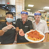 200805 Como Open 1<br /> James Neiss/staff photographer <br /> Niagara Falls, NY - The Antonacci family, owners of the Como restaurant on Pine Avenue, want everyone to know they are again open for business. Family members Barbara Antonacci, Louie Antonacci and Frank Antonacci show off their signature spaghetti and meatballs.