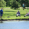 200601 Enterprise 2<br /> James Neiss/staff photographer <br /> Sanborn, NY - It was men's day at the park for these guys fishing and smoking cigars at Bond Lake.