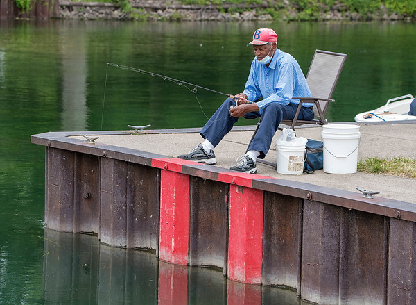 200713 Enterprise 3<br /> James Neiss/staff photographer <br /> Niagara Falls, NY - Joe Hines of Niagara Falls enjoys the morning fishing at the Niagara Falls Boat Docks on Buffalo Avenue. Hines said, they (fish) might be small, but they are biting.