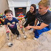 James Neiss/staff photographer <br /> Lockport, NY - Dante Fick, 4, is a happy little boy who's battling SPG52, an ultra-rare neurodegenerative condition, and his parents Carrie and Mike, are holding a fundraiser to help raise money for a cure. From left are, Dante Fick, 4, Spencer the dog and parents Carrie & Mike Fick.