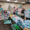 James Neiss/staff photographer <br /> Lockport, NY - Members of Newborns In Need, from left, Sharon Sanmarco, Mary Dunning, Debby Bulmer, Dee Judy, Cheryl Reed and Sharon Rupert, show off items they created or were donated for needy children. Chapter Director Mary Dunning, said the group is 100% volunteer , all items are free to new moms and donations are welcome. Those interested in joining the group will find them at the Lockport Library on the 4th Thursday of the month.