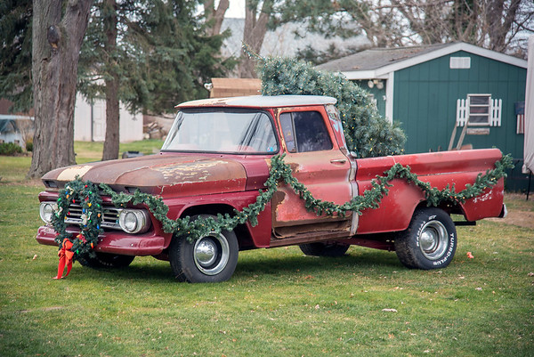 201216 Holiday Decorations 2<br /> James Neiss/staff photographer <br /> Lewiston - A classic pickup, a wreath, garland and a Christmas tree are all you need to decorate your lawn, like this truck on Cayuga Drive.