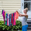200721 Enterprise<br /> James Neiss/staff photographer <br /> Lockporter, NY - Like her mother before her and grandmother before that, Liza Craig of Lakeview Parkway, said she always hangs her clothes outside in the summer. They just smell nice that way, she said.