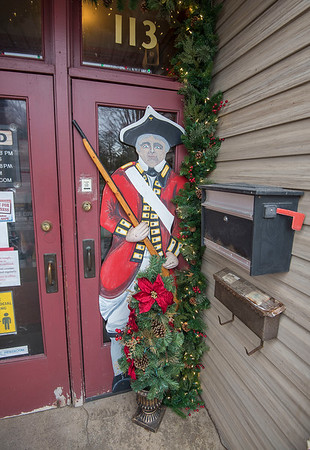 201216 Youngstown Mural 4<br /> James Neiss/staff photographer <br /> Youngstown, NY - One of the original 20 fort soldiers created by Youngstown artist Willy Suitor still adorns the door at Anchor Spirits.