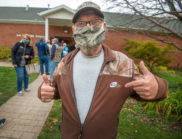 201026 Early Voting 2<br /> James Neiss/staff photographer <br /> Lockport, NY - Dave Huntsman of Newfane said it took him about 40 minutes to get to the front of the early voting line at the 4-H Training Centine on the Niagara County Fairground campus.