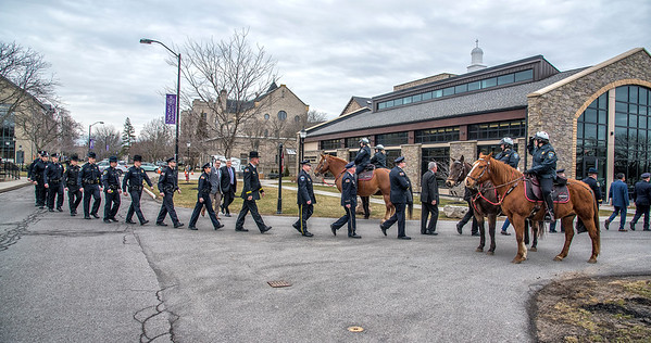 James Neiss/staff photographer <br /> Lewiston, NY - Members of the Niagara County Sheriff's Office Mounted Police salute as dignitaries and graduates pass between. The Niagara County Law Enforcement Academy at Niagara University held their 73rd Basic Course for Police graduation ceremony at the Russell J. Salvatore Dining Commons.