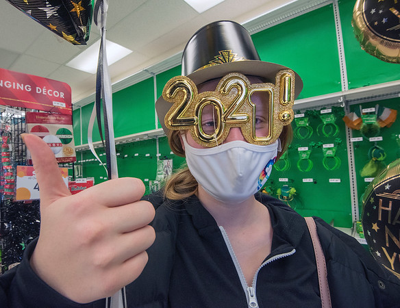 201230 New Years 3<br /> James Neiss/staff photographer <br /> Niagara Falls - Meaghan Gleason, 20, found the perfect combination of party wear to bring in 2021 during a visit to Party City on Niagara Falls Boulevard.