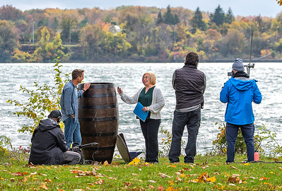 201021 History Channel  James Neiss/staff photographer  Niagara Falls, NY - Local Annie Edson Taylor reenactor Kathy Ordiway is being interviewed by film crews from the History Channel on Goat Island, at Niagara Falls State Park, next to a hand made replica of Taylors barrel. Crew said they plan to drop the barrel from the same height that it went over the falls into water at an undisclosed location to film the effect for an upcoming History Channel special.