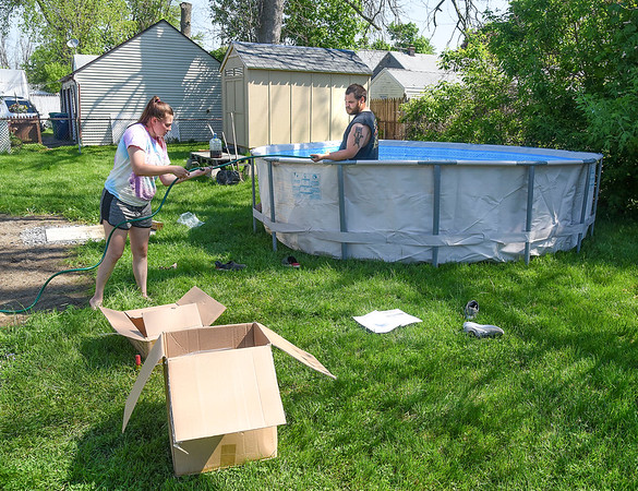 200526 NF Enterprise 1<br /> James Neiss/staff photographer <br /> Niagara Falls, NY - Working Out The Kinks - Kaylee Reinard and boyfriend Zach Jackman were spotted putting together a 3300 gallon pool during the morning heat in their 72nd Street backyard.