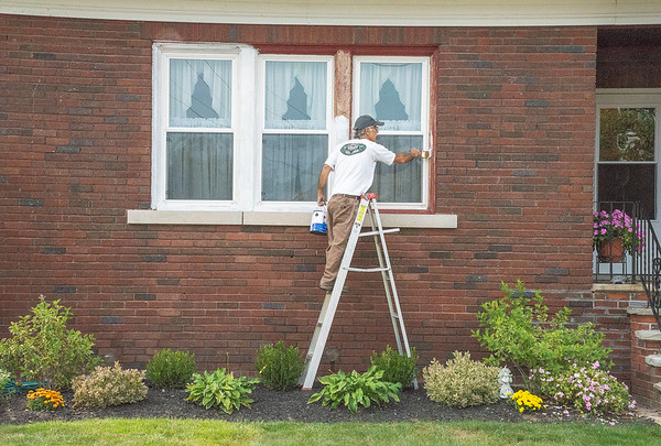 200915 Enterprise 1<br /> James Neiss/staff photographer <br /> Niagara Falls, NY - Tom LePage took advantage of one of the last nice summer days to spruce up the paint on his Macklem Avenue home.