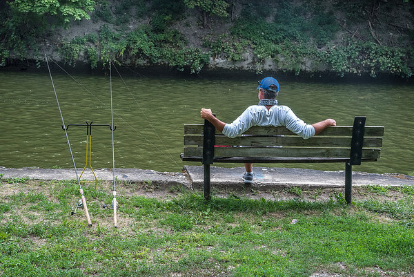 200727 Enterprise 3<br /> James Neiss/staff photographer <br /> Niagara Falls, NY - Why fish with one pole when you can use two like Max Bottone of Olcott who was fishing at Upson Park along the Erie Canal.