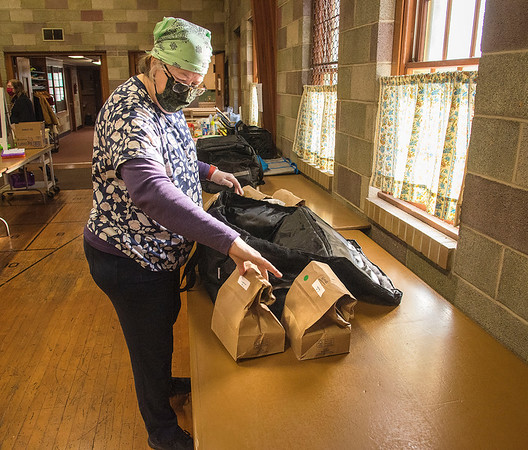 201112 Meals 3<br /> James Neiss/staff photographer <br /> Niagara Falls, NY - Volunteer Anne Orr packs bag lunches for drivers to deliver at the Niagara Falls Meals On Wheels inside St. Paul's Church at 1920 18th Street.