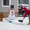 201217 Let it Snow Enterprise 1<br /> James Neiss/staff photographer <br /> Lockport - Kingston Simons helps his dad Dylan clear their Hawley Street sidewalk of snow.