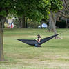 200828 Enterprise 1<br /> James Neiss/staff photographer <br /> Lewiston, NY - Hanging Out - Niagara University Senior Valerie Garcia, a biology major, catches up on some light reading while relaxing on campus in her hammock that she slug up in the shade. A relaxing nap didn't look out of the question either.