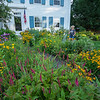 200805 Enterprise 1<br /> James Neiss/staff photographer <br /> Lockport, NY - Deanna Nestoros of Grasmere Road waters her garden that's bursting with color. Nestoros said she has been nurturing her garden for 14 years.