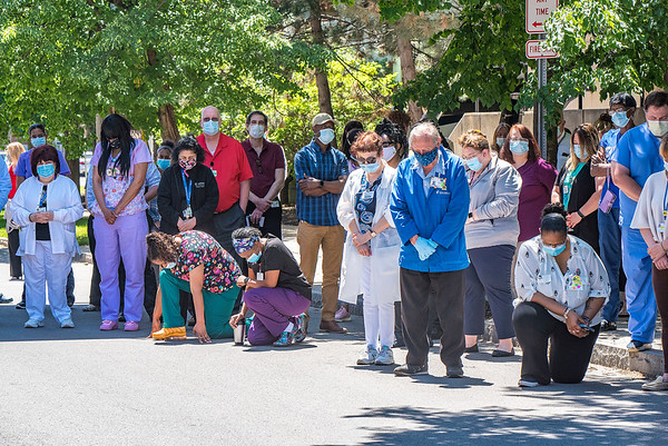 200604 NFMMC Observance 4<br /> James Neiss/staff photographer <br /> Niagara Falls, NY - Staff members at Niagara Falls Memorial Medical listen to a prayer by Robert Bennett, Director of New Patient Behavioral Health, and observe eight minutes and 46 seconds of silence in memory of George Floyed in front of the hospital.