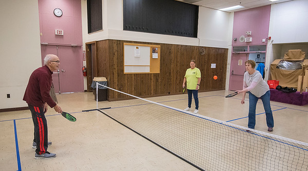 James Neiss/staff photographer <br /> Lockport, NY - Linda Spencer of Gasport and Sharon Collopy of Lockport get a lesson in Pickleball from Don Harrington at the Dale Association where they play Pickleball every monday at 1 pm.  All are welcome!