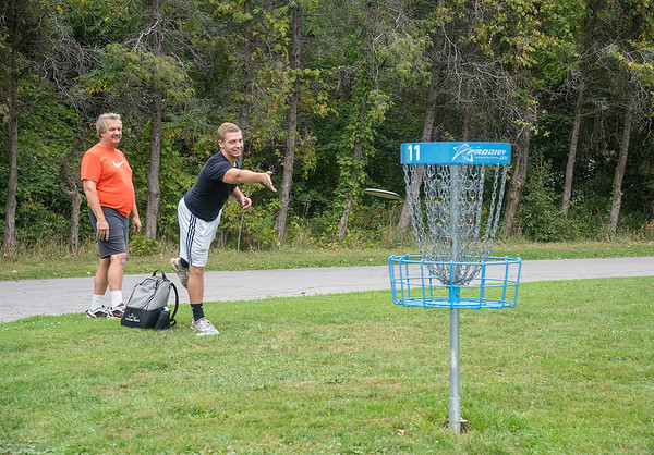 200911 LKPT Enterprise<br /> James Neiss/staff photographer <br /> Lockport, NY - Jonathan Nowakowski of Akron, makes a basket at the Outwater Park disk golf course playing a round with his father Mark.