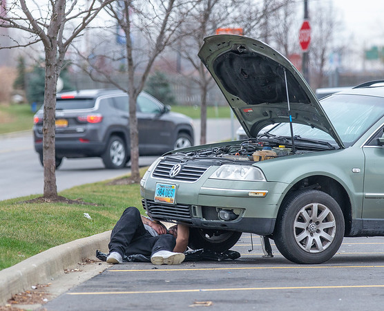 201223 NF Enterprise 1<br /> James Neiss/staff photographer <br /> Niagara Falls - Jesse Ramos of California made an emergency stop in the Walmart parking lot to fix a loose radiator pressure line. Ramos said he was going to try and cross the border to meet up with his wife and her parents in Toronto, Canada for Christmas.